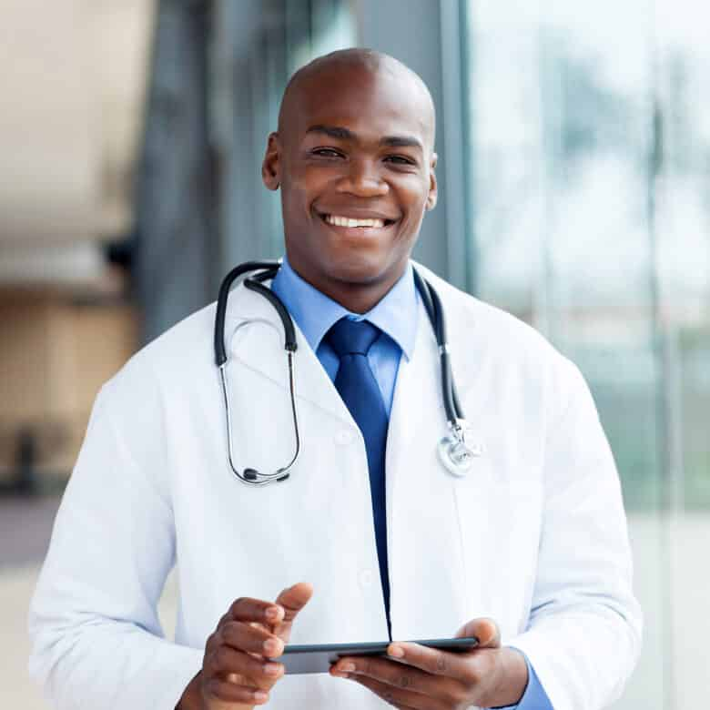 A doctor with a tablet.